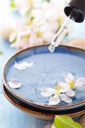 Scented water and flowers. Stock Photos