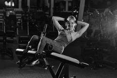 Woman doing strength exercises for abs muscles Stock Photos