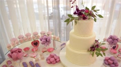 Candy-bar and multi-tiered wedding cakes, decorated cake Stock Footage