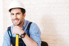 Close-up portrait of handyman with a hard hat - stock photo