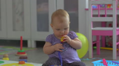 Baby Playing with toys Stock Footage