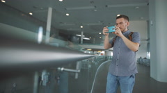 Hipsters at the airport, take a picture using a smartphone - stock footage