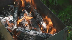 Charcoal on fire in a BBQ grill Stock Footage