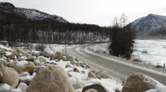 One truck traveling on a mountain road. Sayan mountains. Siberia. Russia. Stock Footage
