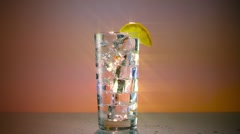 Ice Water Glass with Lemon Wide Star Filter Stock Footage