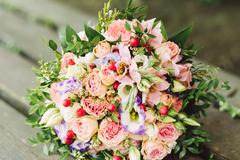 Pink, white and purple roses bride bouquet - stock photo