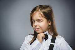 Closeup Portrait of mistrust girl isolated on gray background - stock photo