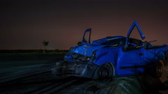 Road accident. Crashed car on the road time lapse, close to a give way  sign Stock Footage