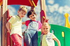 Group of happy kids on children playground Kuvituskuvat
