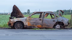 Time lapse of a Trap Car Burned After Bombing of the City Stock Footage