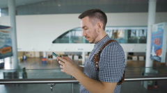 Business travelers at the airport. With the help of the Internet solves their - stock footage