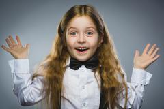 Closeup portrait successful happy girl going surprise isolated on gray - stock photo