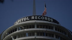 Capitol Records with American Flag flying on blue sky Stock Footage