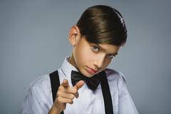 Closeup defiant boy with worried stressed face expression - stock photo
