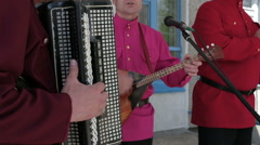 Male hands playing the accordion and balalaika Stock Footage