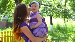 Happy mother having fun outdoors in spring park Stock Footage