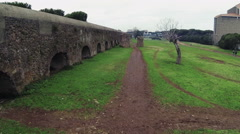 Aerial drone video. Ancient Roman aqueduct. Wall of ancient Rome in a park.  N. Stock Footage