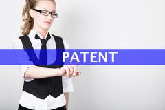 Patent written on a virtual screen. Internet technologies in business and Stock Photos