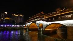 Night view of beautiful Anshun Bridge above Jinjiang river, Stock Footage