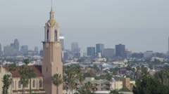 Los Angeles Skyline - Camera Tilt to view hazy smog filled city Stock Footage