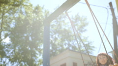 Girl on a swing Stock Footage