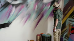 Graffiti artist spray painting and photographing using mobile camera. Stock Footage