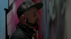 Portrait of graffiti artist. Stock Footage