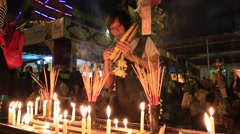 People pray near the Shwedagon Pagoda. Yangon, Burma. Myanmar Stock Footage
