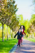 Stylish trendy boy and woman or son with mother playing outdoor Stock Photos