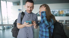 The guy shows something on a smartphone to his girlfriend Stock Footage