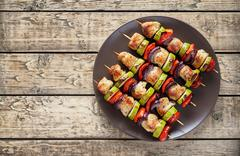 Turkey or chicken shish kebab skewers with pepper tomatoes - stock photo