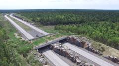 Land Bridge - Wildlife crossing for animals to get across the highway Stock Footage