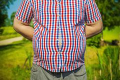 Man with overweight at outdoor in summer Stock Photos