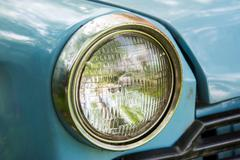 Old car with close-up on headlights - stock photo