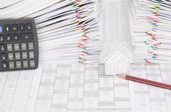House and pencil have dual overload document as background - stock photo