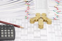 Step pile of gold coins and pencil with dual document - stock photo