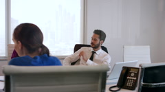 Business colleagues discussing in meeting at conference room. Stock Footage