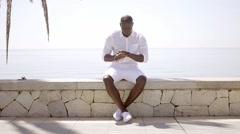 Handsome black model wearing shorts and shirt Stock Footage