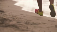 4-Slow motion Active Woman Exercising Running On Beach Stock Footage