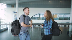 Traveling concept. Waiting for boarding. Happy loving couple in casual wear - stock footage
