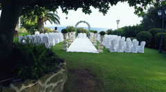 Video of the location of an outdoor wedding. Camera down the aisle. Drone N. - stock footage