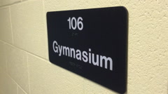gymnasium sign in school hallway - stock footage