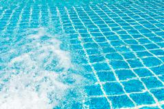 swimming pool rippled water detail - stock photo