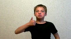 Boy making a surprised face  and thumb up - stock footage