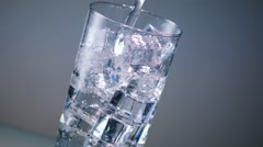 Ice Water Glass Pour Stock Footage
