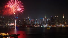 Time-lapse of Fireworks in front of the Midtown Manhattan skyline - stock footage