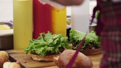 Cooking burger with salad and meat Stock Footage
