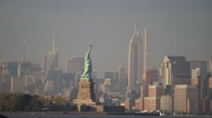 Sunset Time-Lapse of the Statue of Liberty and the Empire State Building Stock Footage