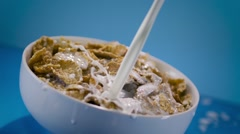 Pouring Milk in Corn Flakes Cereal - stock footage