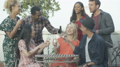 4K Happy attractive friends drinking champagne on city rooftop in the summer Stock Footage